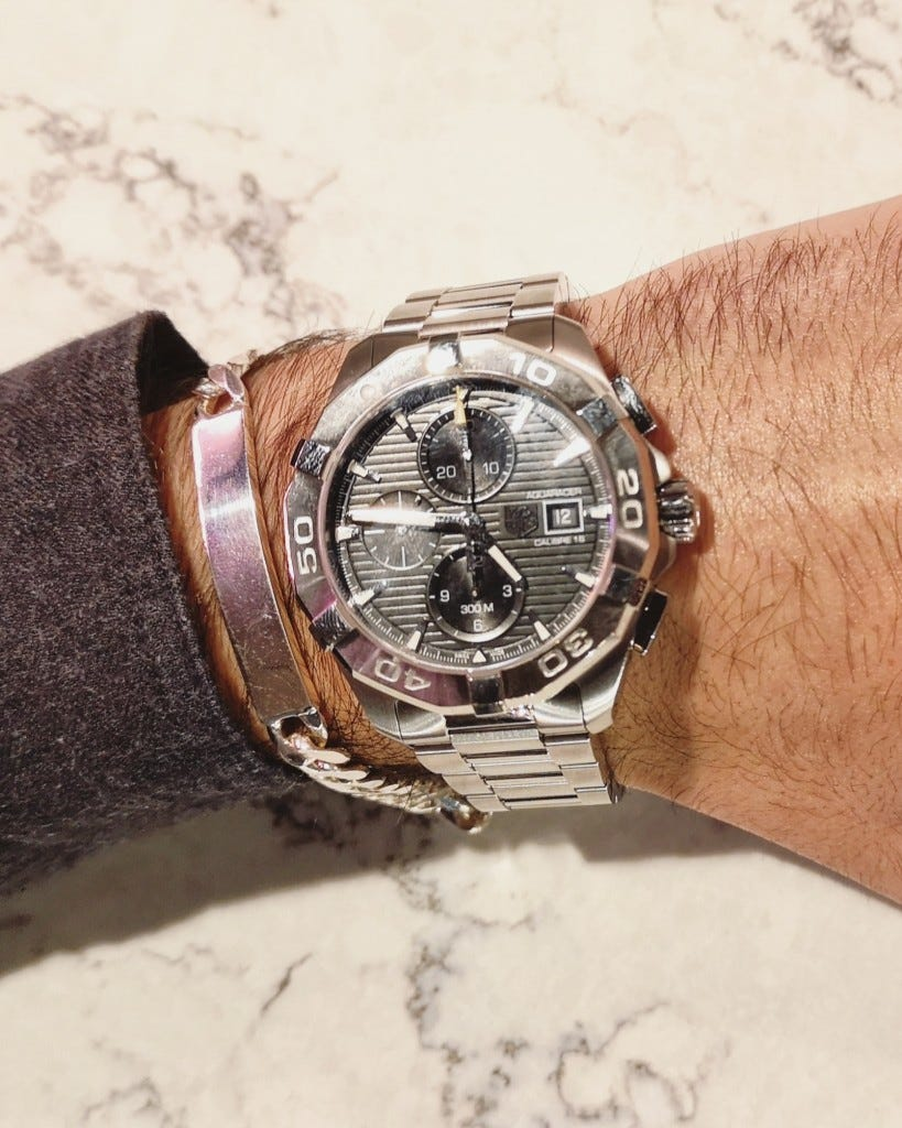 fraser hart mens accessories man wearing steel tag heuer aquaracer watch for him and sterling silver id chain bracelet